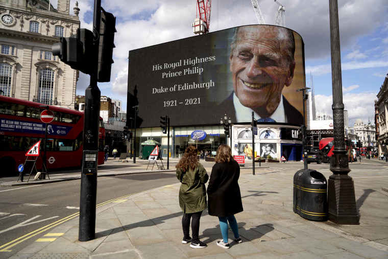 Image: The electronic billboard at Piccadilly Circus displays a tribute to Britain's Prince Philip, Duke of Edinburgh in central London on April 9, 2021 after the announcement of the duke's death.
