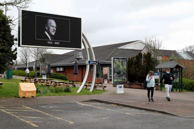Image: An advertising billboard displays a picture in honor of Britain's Prince Philip, Duke of Edinburgh at a service station in Swansea, South Wales, on April 9, 2021 after the announcement of the Duke's death.