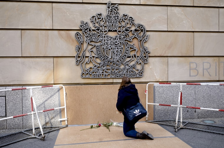 Image: A woman lays down flowers following the announcement of the death of Britain's Prince Philip, outside the British embassy in Berlin, Germany, Friday, April 9, 2021.
