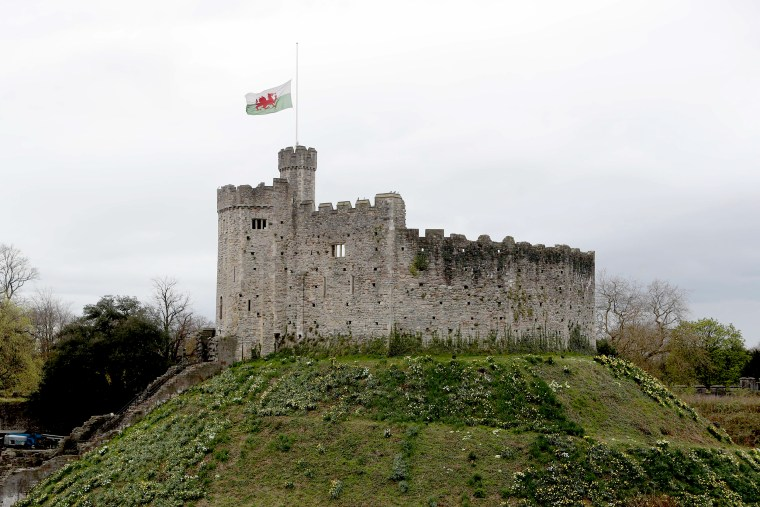 Image: The Flag of Wales flies at half-mast from the Keep at Cardiff Castle in Cardiff, south Wales, on April 9, 2021 following the announcement of the death of Britain's Prince Philip, Duke of Edinburgh.