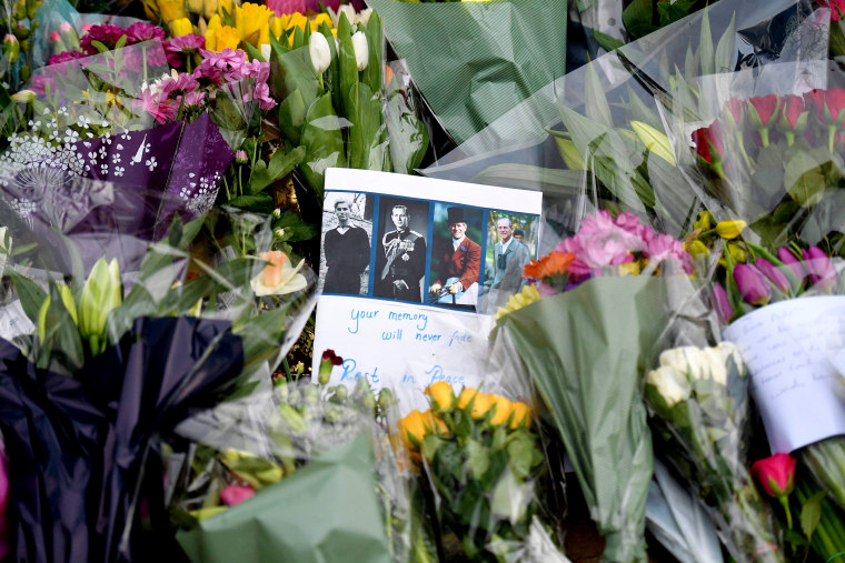 Image: Floral tributes collect at the gates of Buckingham Palace in central London on April 9, 2021 after the announcement of the death of Britain's Prince Philip, Duke of Edinburgh.