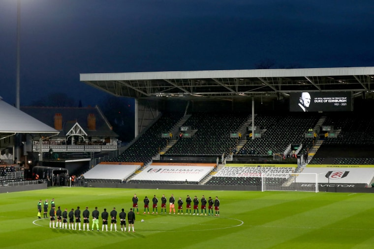 Image: Players from both sides observe a minute's silence to honor Britain's Prince Philip, Duke of Edinburgh