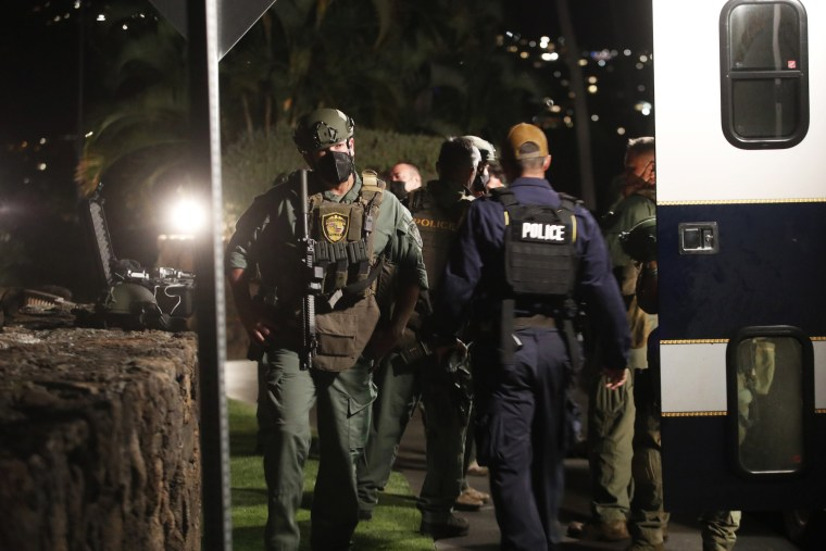 Members of the Honolulu Police Specialized Services Division respond to a barricade situation with an armed man at the Kahala Hotel in Honolulu on April 10, 2021.