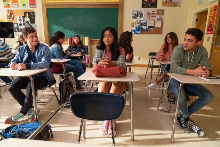 "Jaren Lewison as Ben Gross, Maitreyi Ramakrishnan as Devi Vishwakumar, and Darren Barnet as Paxton Hall-Yoshida in episode 201 of ""Never Have I Ever."""