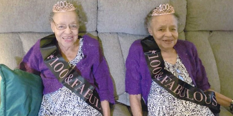Twins Elaine Foster, left, and Evelyn Lowe dressed up for a special celebration as they turned 100 on March 31, 2021.