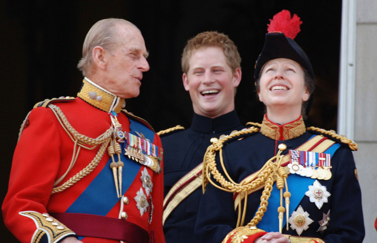 Image: Prince Philip, Duke of Edinburgh, Prince Harry and Princess Anne look on from the balcony during The Queen's Birthday Parade and Trooping The Colour at Buckingham Palace.