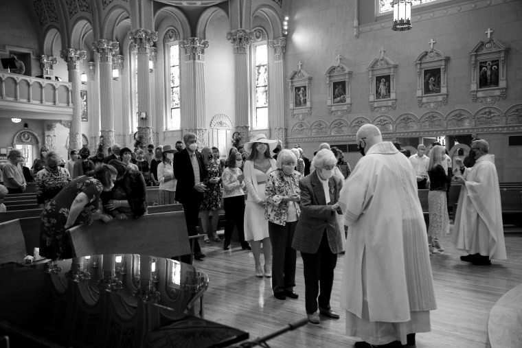 Image: Worshippers at an Easter Sunday service at St. James Catholic Church in Louisville, Ky., on April 4, 2021.