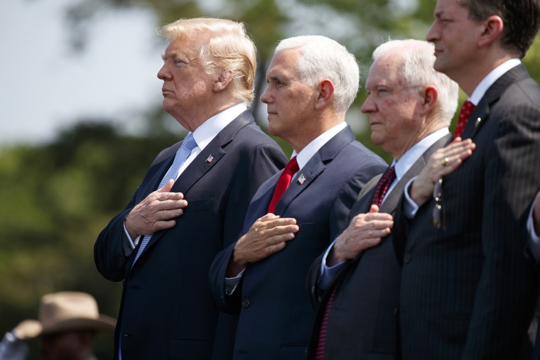 President Donald Trump stands with Vice President Mike Pence, Attorney General Jeff Sessions, and Secretary of Labor Alex Acosta for the national anthem