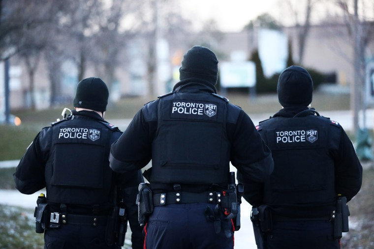 Police officers in Toronto on Dec. 18, 2020.