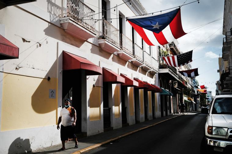 Image: People walk through Old San Juan on March 21, 2021 in San Juan, Puerto Rico.