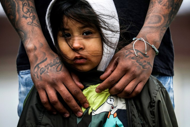 Image: Jose Chavez wraps his arms around his daughter, Cattleya Chavez, 3, at a protest outside the Brooklyn Center Police Department in Minnesota on April 13, 2021.