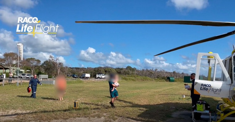 Image: A two-year-old boy is airlifted to a hospital with bites to his head and body after a dingo attacked him on Fraser Island, Australia