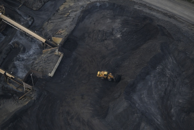 Image: A front loader moves coal at a surface mine in Oakland City, Ind.