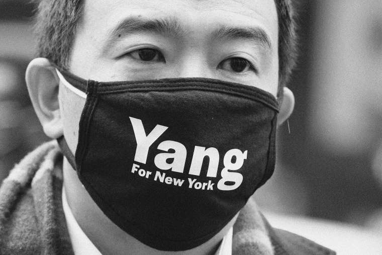 Image: New York City Mayor Andrew Yang campaigns in Times Square in New York City