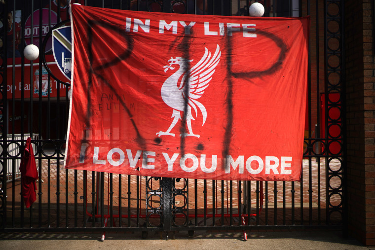 Image: Banners and football scarves are tied to the fences around Anfield Stadium, the home of Liverpool Football Club, in protest at the club's intentions to join the European Super League