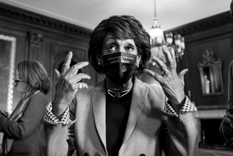 Image: Rep. Maxine Waters, D-Calif., speaks as she waits for the verdict in the murder trial of former Minneapolis police officer Derek Chauvin on Capitol Hill on April 20, 2021.