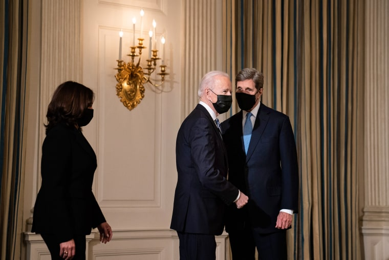 President Joe Biden greets Special Presidential Envoy for Climate John Kerry as he arrives to speak about climate change issues in the State Dining Room of the White House on Jan. 27, 2021.