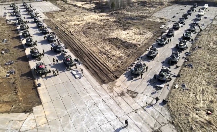 Image: Russian military vehicles move during drills in Crimea