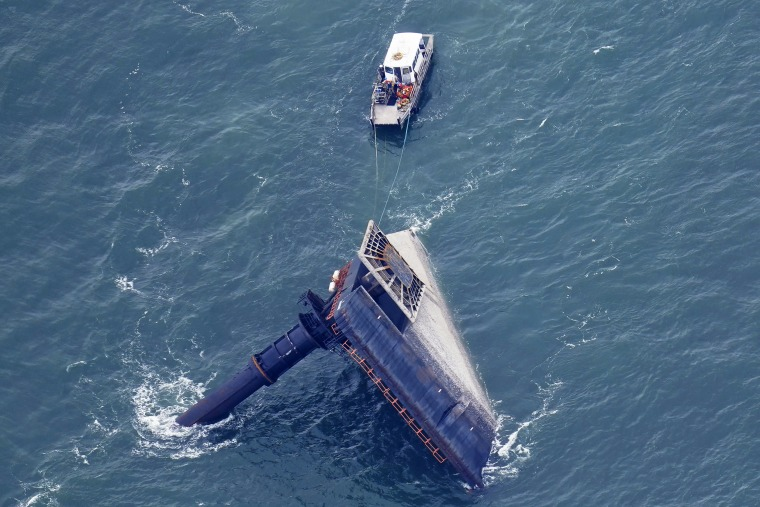 A rescue boat is seen next to the capsized lift boat Seacor Power seven miles off the coast of Louisiana in the Gulf of Mexico on April 18, 2021.