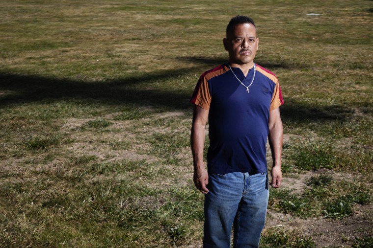 A plane casts a shadow behind Miguel Alarcon in Hillview Park in East San Jose.