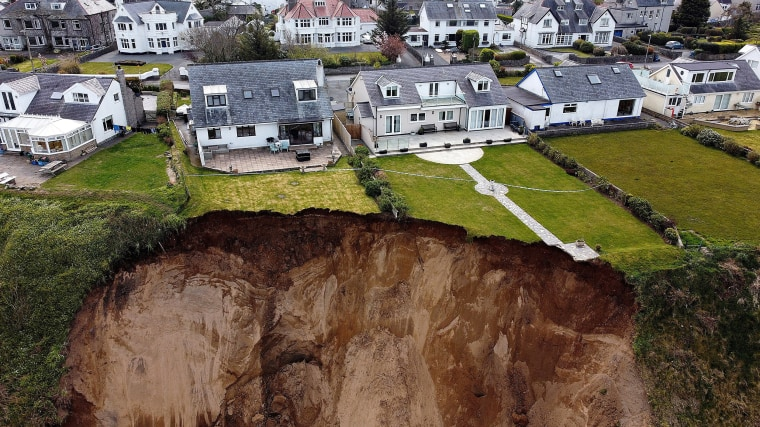 Image: Rockfall is seen on a beach after a cliff collapsed in the village of Nefyn, Wales.