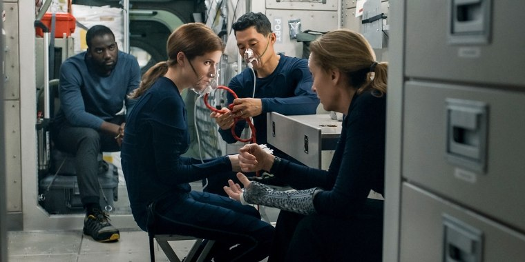 "Shamier Anderson as Michael Adams, Anna Kendrick as Zoe Levenson, Daniel Dae Kim as David Kim, and Toni Collette as Marina Barnett in ""Stowaway\"" on Netflix."