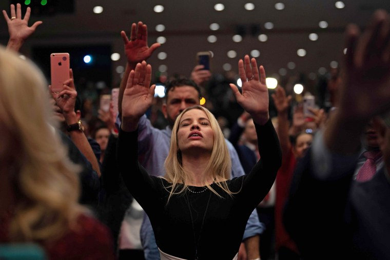 """Supporters pray as President Donald Trump speaks during a \""""Evangelicals for Trump\"""" campaign event held at the King Jesus International Ministry on Jan. 3, 2020 in Miami."""