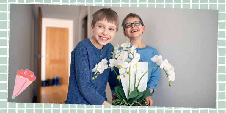 Two Little boys carrying a flower for their mother for Mother's Day
