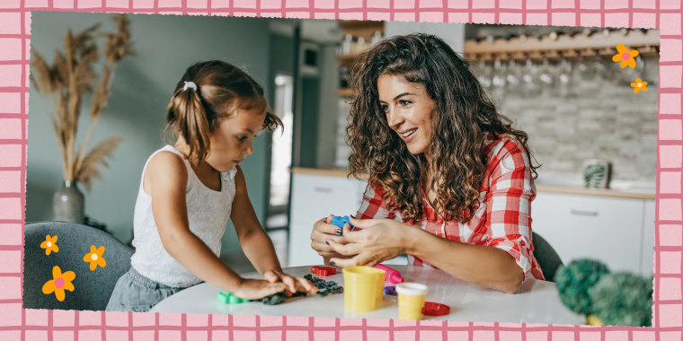 Mother and Daughter sitting at a table playing with a DIY kit