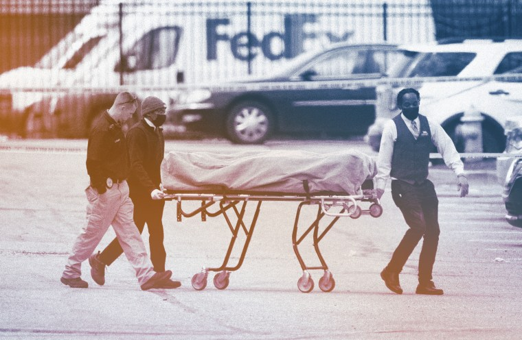 Image: A body is transported from a Fedex facility in Indianapolis on April 16, 2021, the day after a gunman killed eight workers there.