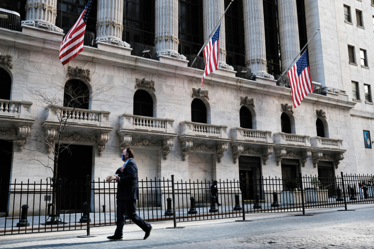 A pedestrian passes the New York Stock Exchange on Feb. 25, 2021 in New York.