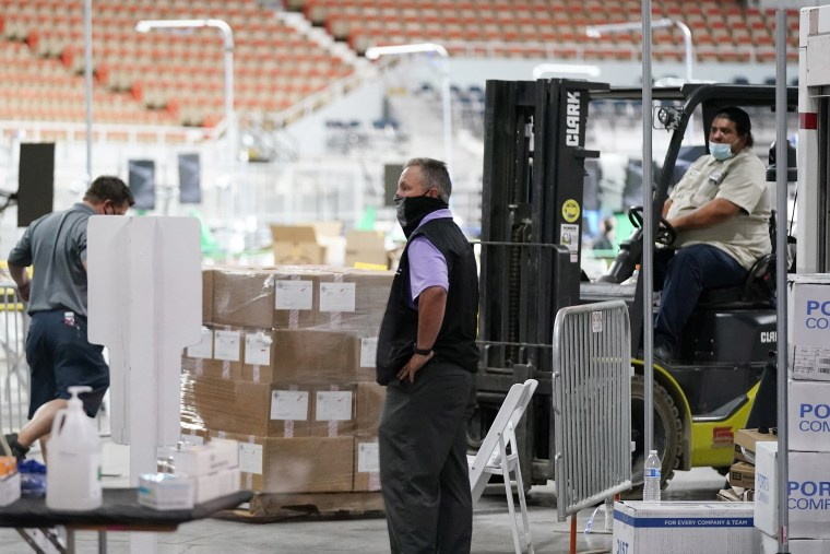 Image: Some of the 2.1 million ballots cast during the 2020 election, are brought in for recounting at a 2020 election ballot audit ordered by the Republican lead Arizona Senate at the Arizona Veterans Memorial Coliseum