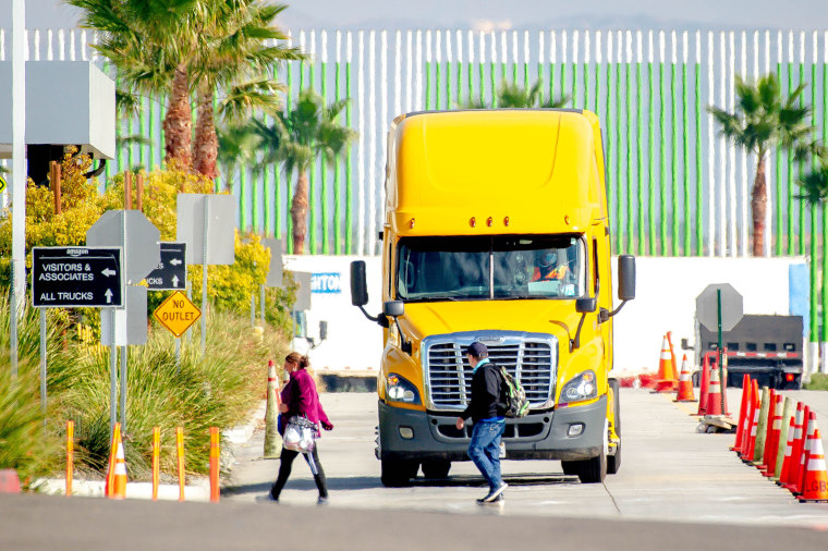 A truck leaves an Amazon Fulfillment Center in Eastvale, Calif. on Nov. 12, 2020.