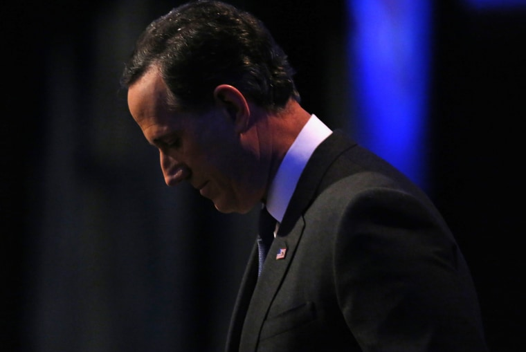 Former Sen. Rick Santorum stands offstage during a break in the midst of a forum for the lower polling candidates in Des Moines, Iowa, on Jan. 28, 2016.