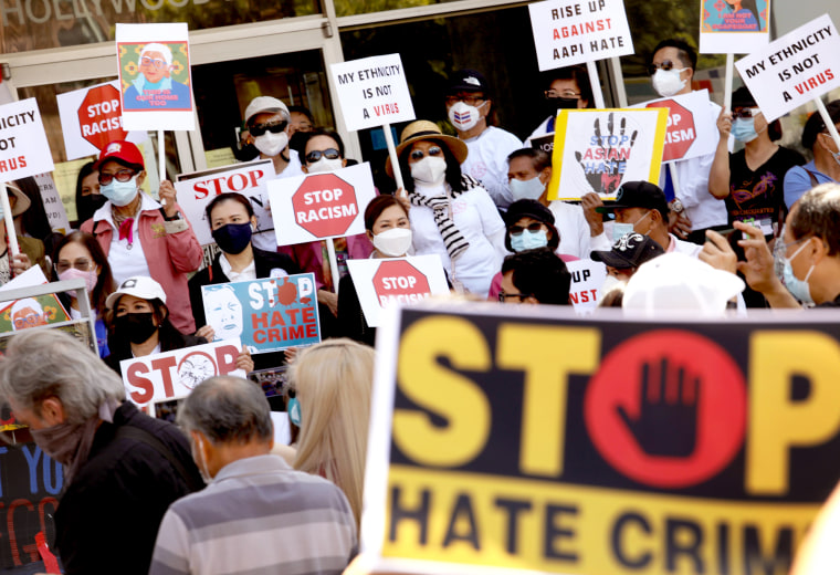 Members of the Thai-American community along with political leaders and members of law enforcement participate in a rally against Asian hate crimes in Thai Town in Los Angeles on April 8, 2021.