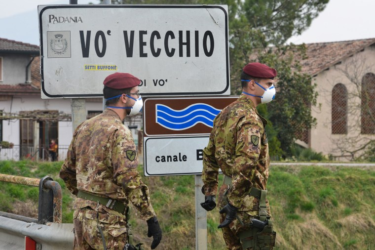 Image: Italian soldiers patrol by a check-point at the entrance of the small town of Vo Vecchio,  situated in the red zone of the Covid-19, northern Italy