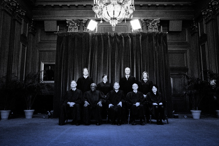 IMage: The Supreme Court Justices pose for a group photo in Washington on April 23, 2021.