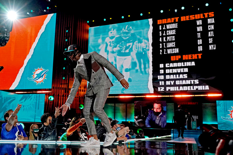 Image: Jaylen Waddle greets fans after being selected by the Miami Dolphins in the 2021 NFL Draft in Cleveland on April 29.