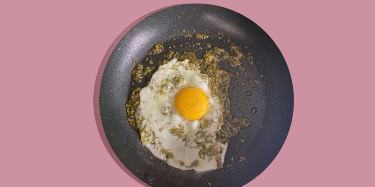 Cooking my egg in pesto resulted in a flavorful, perfectly cooked egg that didn't stick to the pan.
