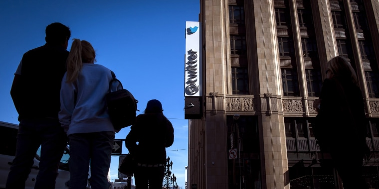 Pedestrians pass in front of Twitter Inc. headquarters in San Francisco on Feb. 8, 2018.