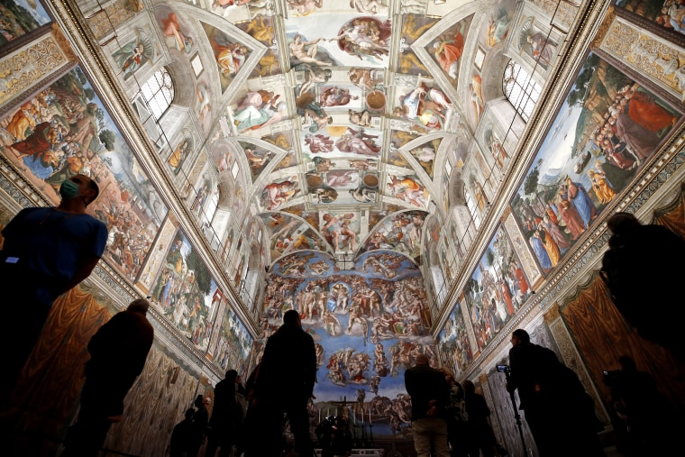 Visitors admire the Sistine Chapel inside the Vatican Museums on the occasion of the museum's reopening, in Rome, Monday, May 3, 2021. The Vatican Museums reopened Monday to visitors after a shutdown following COVID-19 containment measures.