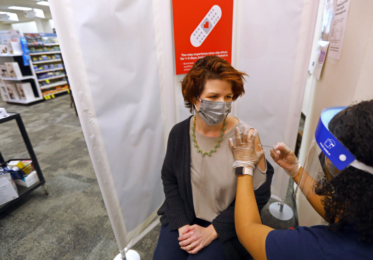 Image: A woman gets a Covid-19 vaccine at a CVS Pharmacy in Providence, R.I., on March 4, 2021.