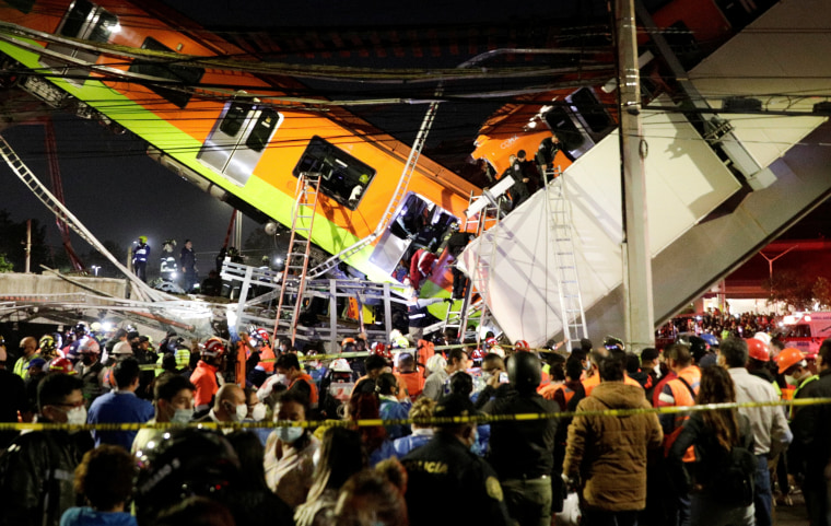 Image: Rescuers work at a site where an overpass for a metro partially collapsed with train cars on it at Olivos station in Mexico City