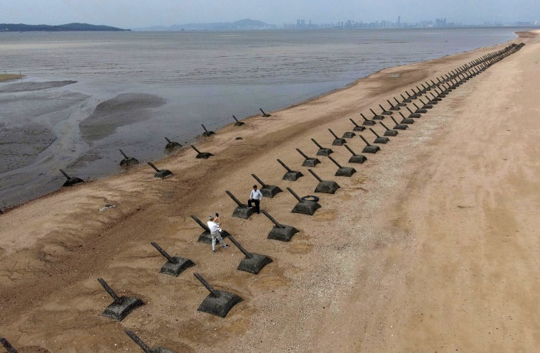 Image: Tourists visiting the anti landing spikes on the coast of Kinmen, the front line islands of Taiwan,