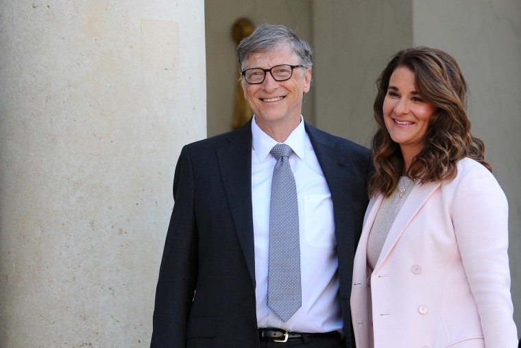 Image: Bill and Melinda Gates pose in front of the Elysee Palace before receiving the award of Commander of the Legion of Honor