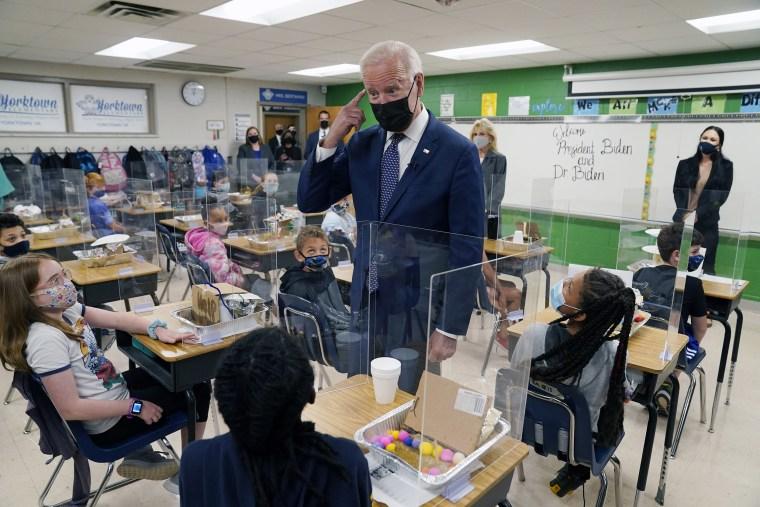 Image: President Joe Biden talks to students during a visit to Yorktown Elementary School, in Yorktown, Va.