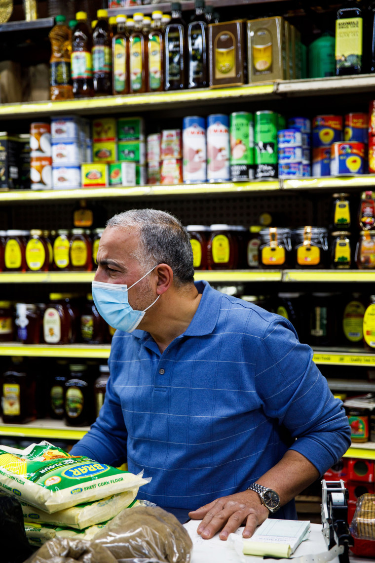 Hamed Nabawy Hamed talks with a customer at his halal grocery store Fertile Crescent in Brooklyn, N.Y., on May 5, 2021.