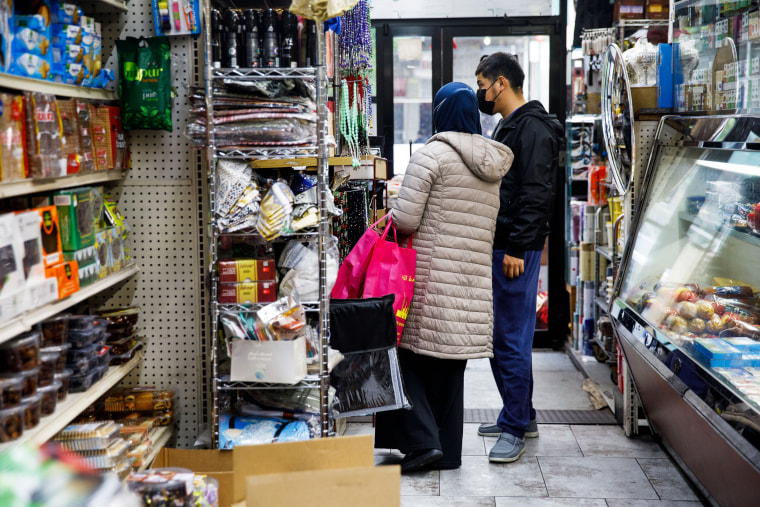 Customers shop at the halal grocery store Fertile Crescent in Brooklyn, N.Y., on May 5, 2021.