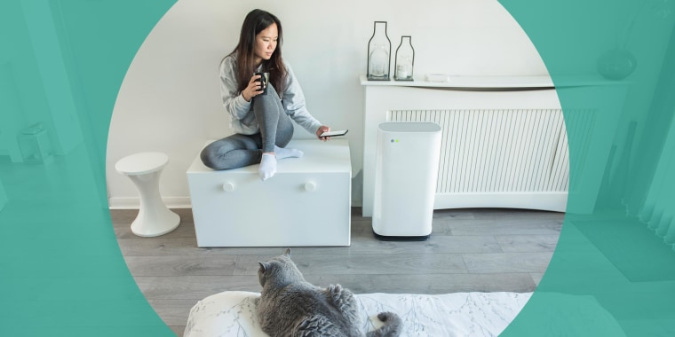 Woman sitting in her room adjusting temperature of her Portable AC unit. These are the best affordable portable air conditioners in 2021. Shop the best portable air conditioning units from Frigidaire, BLACK+DECKER and more.