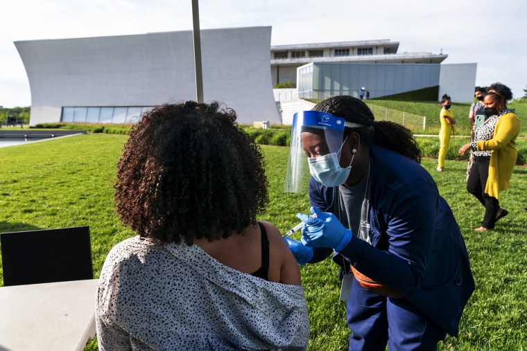 Nurse Kendria Brown vaccinates administers a Johnson & Johnson Covid-19 vaccination at the Kennedy Center in Washington.